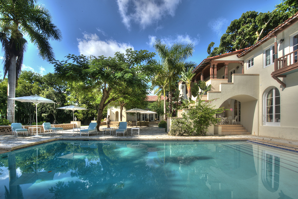 The property features a coral stone patio with a swimming pool.