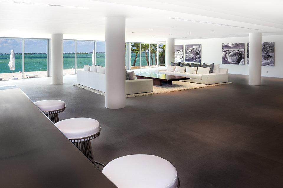 This Miami Beach home once belonged to musician Lenny Kravitz. The living room overlooks Biscayne Bay