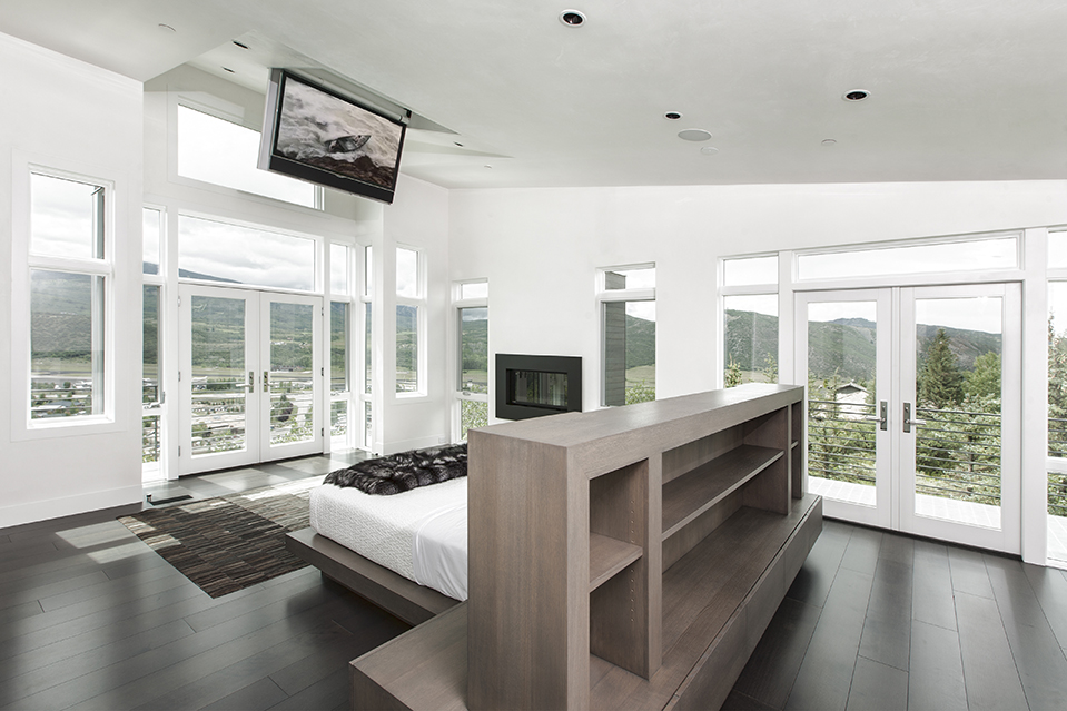 The master bedroom is pictured. It opens to a terrace.