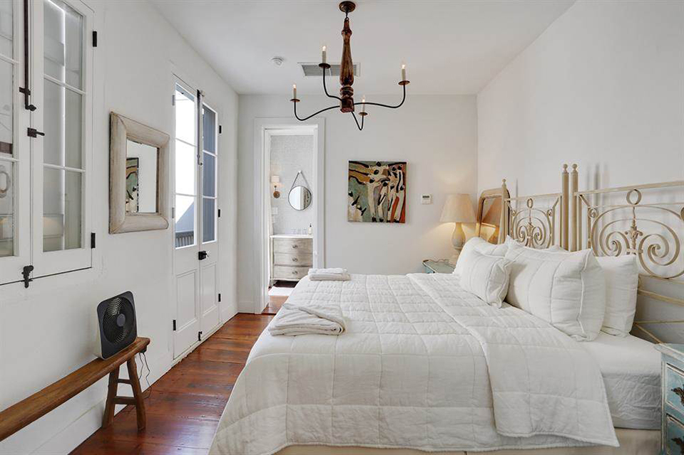 A copper chandelier hangs in the dependency's third-floor bedroom.