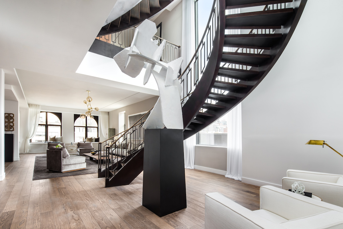 A dramatic sculpture at 66 East 11th Street draw the buyer's eye to the stunning focal point of the u
