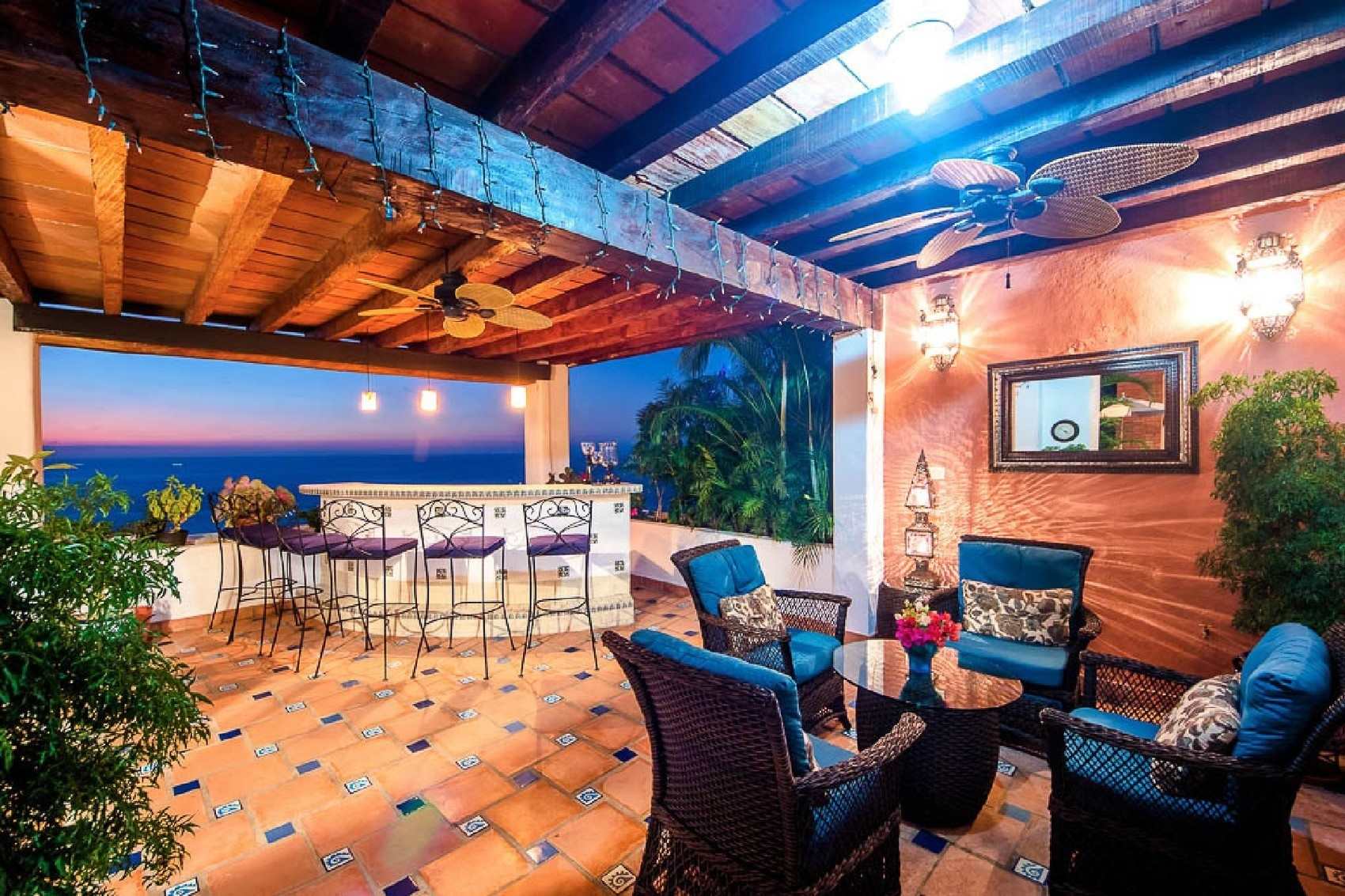 Pictured is an outdoor entertainment area of a waterfront apartment in Conchas Chinas. The four bedro