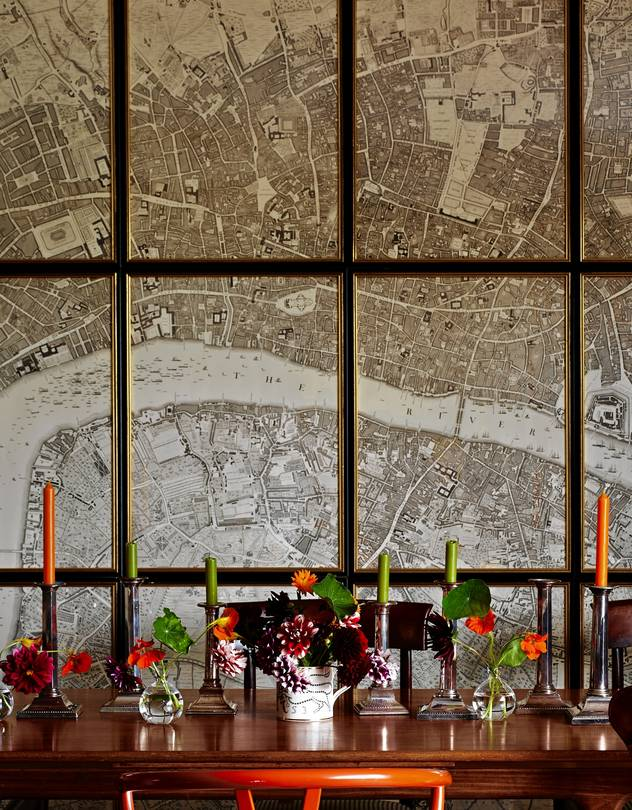 BLOCK PARTY A map of Georgian London behind British designer Ben Pentreath's dining table, as shown i