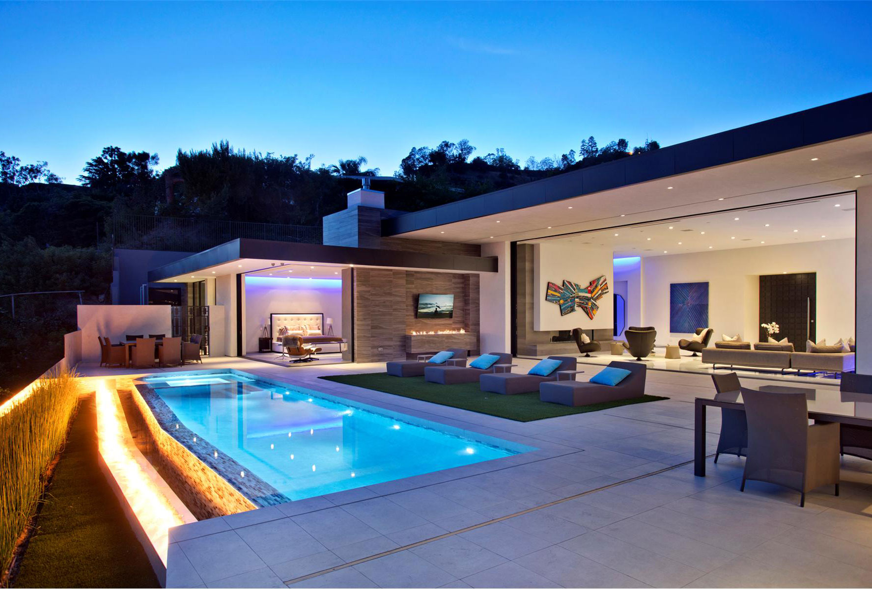 The home's BBQ area includes an outdoor television—just one of the home's many screens.