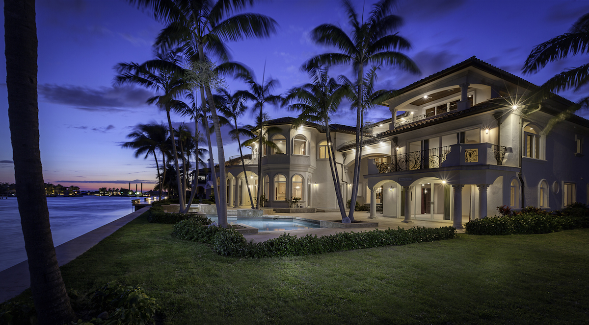 The Mediterranean-inspired estate is seen at night.