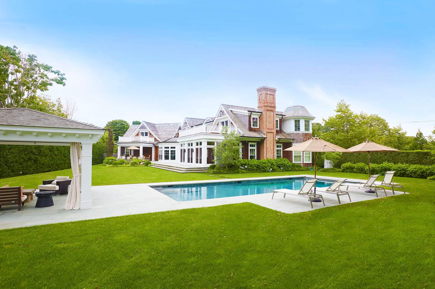 950 Ocean Road, Bridgehampton$9.25 millionJust a quick drive or bike ride to the bars and restaurants in the village of Bridgehampton, this traditional six-bedroom, seven-and-a-half bathroom home is also close to some of the Hamptons best beaches. It features an open floor plan, designer kitchen with a butler's pantry, a paneled library and a master suite with a private terrace and fireplace. There's also a guest suite with a sun deck and a separate staircase. Outdoor amenities include a covered pool, a screened porch with radiant heat and a fireplace and an outdoor kitchen with a built-in barbecue.