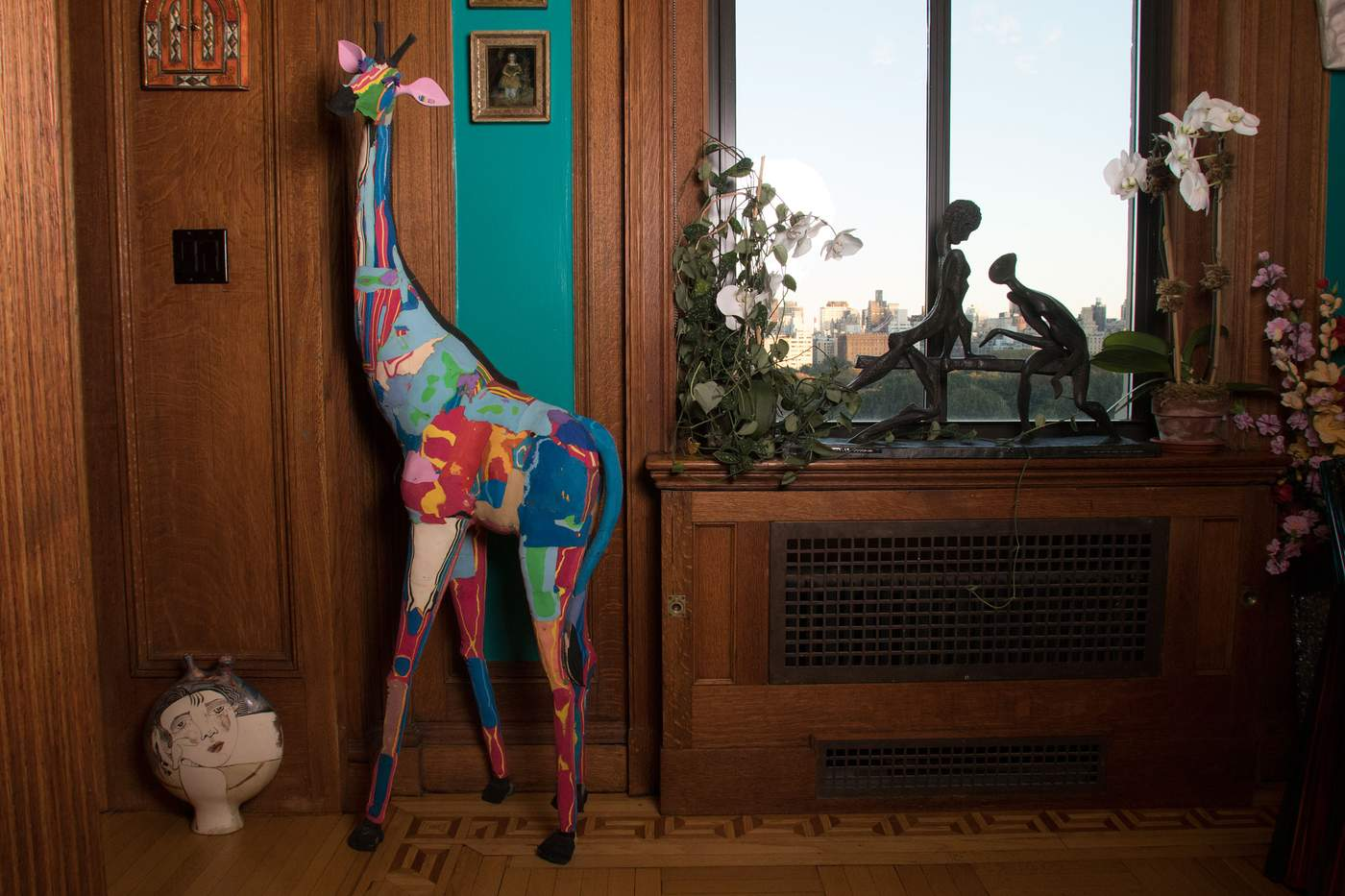 "10. Giraffe made of recycled flip-flops, from East AfricaThis piece was used in a store window, Ms. Arbus said. ""When people come over, I ask if they can tell me what it's made of, and only one person has guessed right. It's fun, it's colorful. I'm crazy for animals and I really love giraffes. ...""There's a lot of turquoise and green with splashes of yellow, and the room has yellow ceilings and turquoise walls. And his little ears are pink and take you right into the adjacent parlors."""