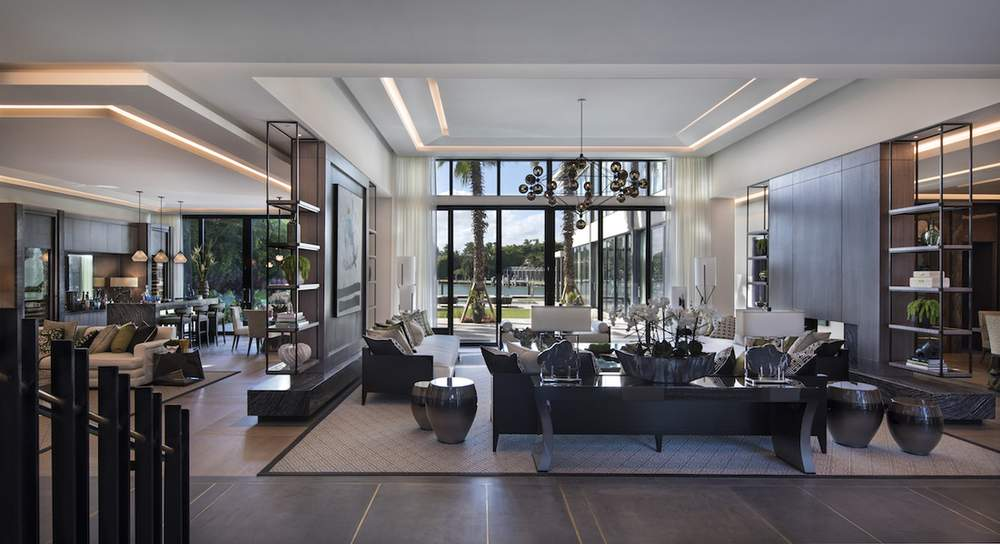 Interior designer Nicola Fontanella created ceilings at different heights to reflect division between a drawing room to the dining room and kitchen in this open floor plan Miami home.