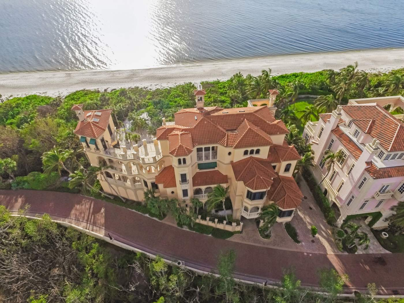 7607 Bay Colony DrivePrice: $19.975 millionAgent: Joe BelzThe beach is just a few steps from this 9,775-square-foot Mediterranean-style home, which is part of the secluded community of the Strand at Bay Colony. Sitting on more than an acre of land, the four-bedroom, six-bathroom and two half-bathroom house has views of the Gulf of Mexico, a master suite with a sitting area and fireplace, plus a marble bathroom and several terraces and balconies overlooking the water. Part of living at Bay Colony is access to its amenities, like the remodeled beach club, a beachfront pool, tennis courts and optional membership to one of of two golf courses.