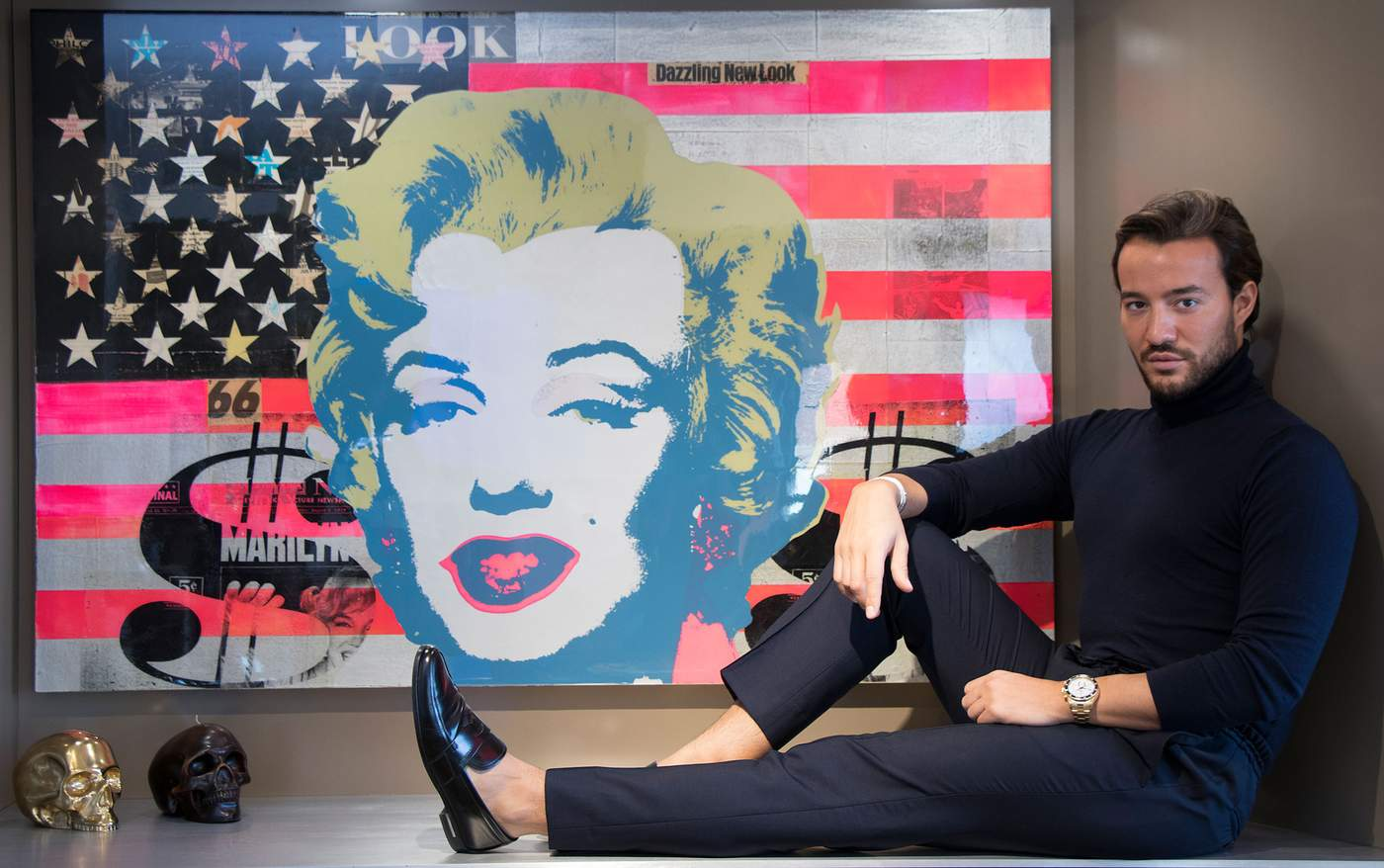 "1.   ""Dazzling Marilyn Flag,"" Robert Mars, mixed media, features original vintage papers from the '50s and '60s, acrylic paint and pop art collage. It is assembled onto plywood, and over this is a coat of UV resin. 2011 ""It was my first art purchase when I moved to New York, Mr. Bahadir said. ""I was in SoHo with my mother looking at galleries, and it was warm and charming from the street, and I had to go in [to DTR Modern Galleries]. It gives me an amazing energy and makes me think of when I first moved [here]. As you dim the lights, the articles in the collage pop up more."""