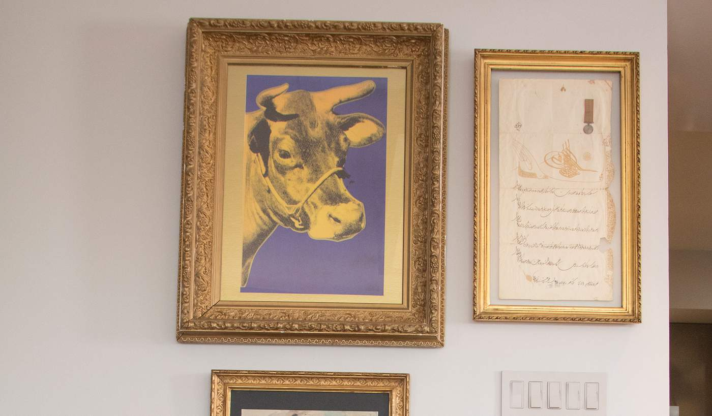 """7.      """"Purple Cow,"""" Andy Warhol, silk print, 1967""""My mother pushes me to stay away from prints. ...So we had conversations about the cow. It's Andy Warhol's work but in a frame I bought in Paris from the 1700s,"""" Mr. Bahadir said. """"When I decided to put it in a vintage frame, my mom was like, 'Now I like the idea.'"""""""