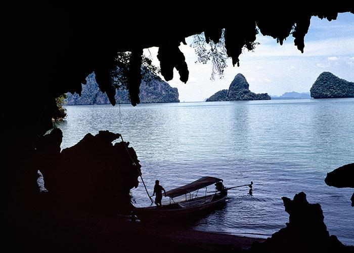 A boat is moored inside one of the limestone caves in Phang Nga Bay.Photo: Ben Davies/Getty Images