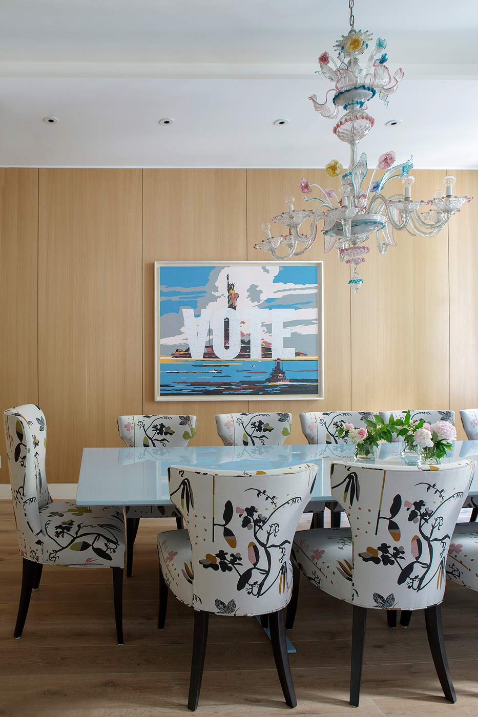 Dining room chairs decked in an abstract floral print lend a whimsical vibe to this room designed by the novogratz photography by costas picadas